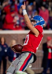 Ole Miss quarterback John Rhys Plumlee salutes the fans after scoring a touchdown against LSU on Nov. 16, 2019.