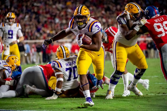 Nov 16, 2019; Oxford, MS, USA; Louisiana State Tigers running back Tyrion Davis-Price (3) runs in for a touchdown during the first quarter against the Mississippi Rebels at Vaught-Hemingway Stadium. Mandatory Credit: Vasha Hunt-USA TODAY Sports