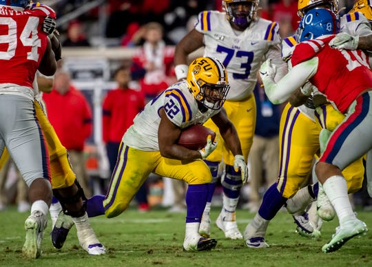 Nov 16, 2019; Oxford, MS, USA; Louisiana State Tigers running back Clyde Edwards-Helaire (22) breaks through a hole against the Mississippi Rebels in the fourth quarter at Vaught-Hemingway Stadium. Mandatory Credit: Vasha Hunt-USA TODAY Sports