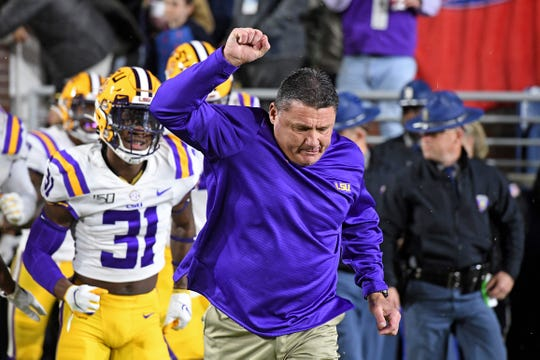 LSU head coach Ed Orgeron leads the team on the field before the first half of an NCAA college football game against Mississippi in Oxford, Miss., Saturday, Nov. 16, 2019. (AP Photo/Thomas Graning)