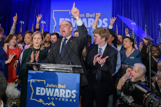 Louisiana Gov. John Bel Edwards, who defeated Republican Eddie Rispone to win a second term, addresses supporters at his election night watch party Saturday in Baton Rouge, La., Saturday, Nov. 16, 2019. (AP Photo/Matthew Hinton)