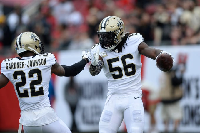 New Orleans Saints outside linebacker Demario Davis (56) celebrates with defensive back Chauncey Gardner-Johnson (22) after recovering a fumble by the Tampa Bay Buccaneers during the first half of an NFL football game Sunday, Nov. 17, 2019, in Tampa, Fla. (AP Photo/Jason Behnken)