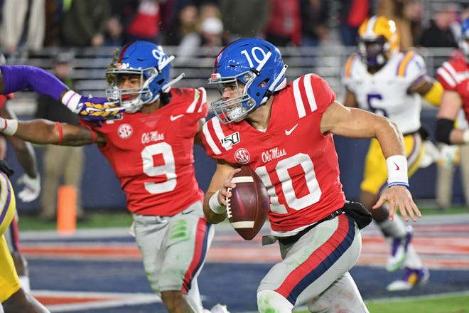 Ole Miss quarterback John Rhys Plumlee (10) runs the ball during the second half of an NCAA college football game against LSU in Oxford, Miss., Saturday, Nov. 16, 2019. No. 1 LSU won 58-37.