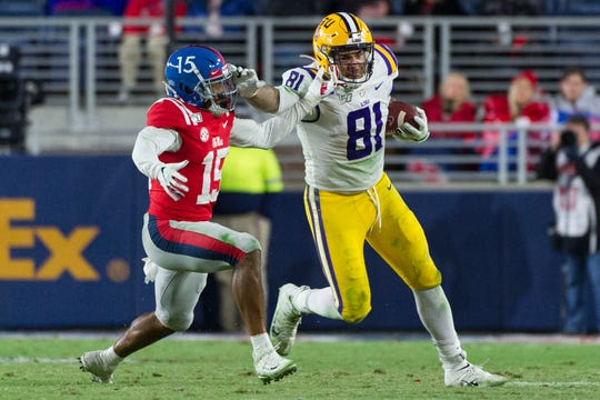 Nov 16, 2019; Oxford, MS, USA; LSU Tigers tight end Thaddeus Moss (81) stiff arms Mississippi Rebels defensive back Myles Hartsfield (15) during the second half at Vaught-Hemingway Stadium. Mandatory Credit: Justin Ford-USA TODAY Sports