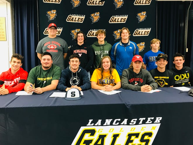 Lancaster High School held a signing ceremony for several athletes, who will be furthering their education and playing sports at the college level. Those signing were, front row, left to right: Tyler Rockwood (Ohio State, gymnastics), Bryan Connell (Tiffin, track and field), Casey Finck (Penn State, baseball), Leah Tipple, (Toledo, softball), Riley Wright (Youngstown State, track and field), Caleb Cordle (Ohio Dominican, track and field) and Orion Thress (Ohio Dominican, track and field). Second row, L-R: Quinton Burke, (Ohio State, football), Wes Ward (Youngstown State, baseball), Evan Sines, East Michigan, baseball), Curtis Young (Air Force Academy, football) and Logan Agin, (Duke, wrestling).