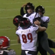 Louisville kicker Ryan Chalifoux celebrates with teammates after throwing a touchdown against NC State