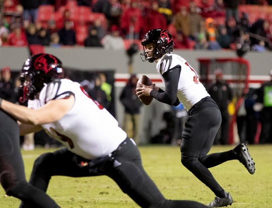 Louisville's kicker Ryan Chalifoux fakes a field goal and throws for a touchdown in the Cardinals game against N.C. State on Nov. 16, 2019