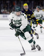 Michigan State's Jerad Rosburg races up the ice against Michigan during the second period, Saturday, Nov. 16, 2019, in East Lansing, Mich. Michigan State won 3-0.