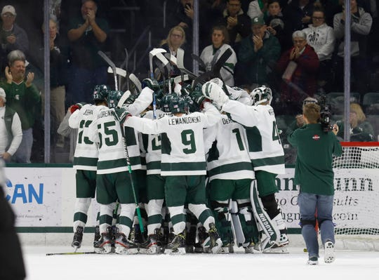 Michigan State players celebrate their 3-0 win over Michigan, Saturday, Nov. 16, 2019, in East Lansing, Mich.