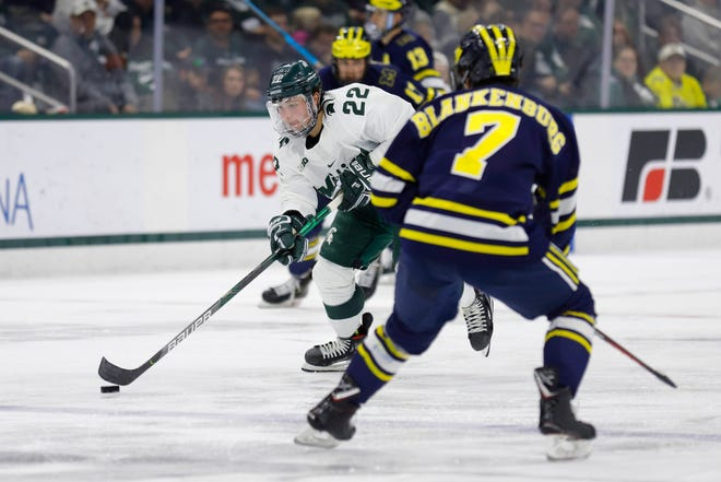 Michigan State's Dennis Cesana (22), shown earlier this season against Michigan, had a goal and two assists in the Spartans' 5-2 win over Ferris State on Tuesday in the third-place game of the Great Lakes Invitational at Little Caesars Arena in Detroit.