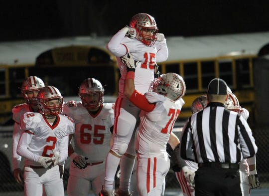 Shelby's Evan Bogner celebrates with his teammates after catching a 20-yard touchdown pass in Saturday's 35-21 loss to Clyde in a Division IV regional semifinal playoff game.