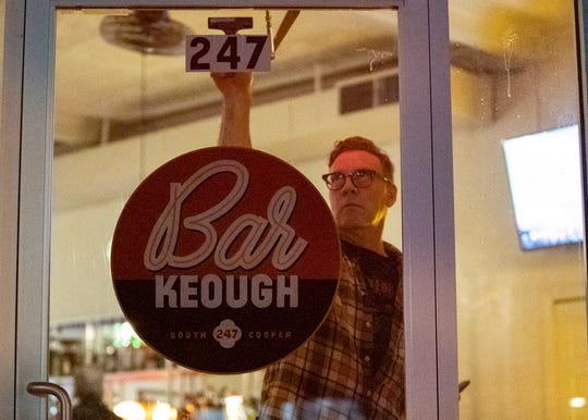Kevin Keough prepares for the soft opening his new bar, Bar Keough, on Saturday. The bar officially opens on Wednesday.
