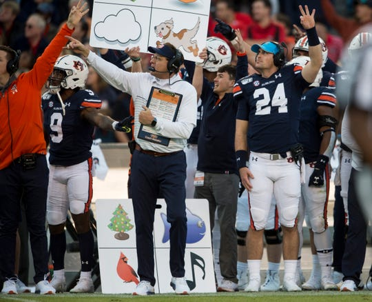 Auburn head coach Gus Malzahn points to a replay at Jordan-Hare Stadium in Auburn, Ala., on Saturday, Nov. 16, 2019. Georgia defeated Auburn 21-14.