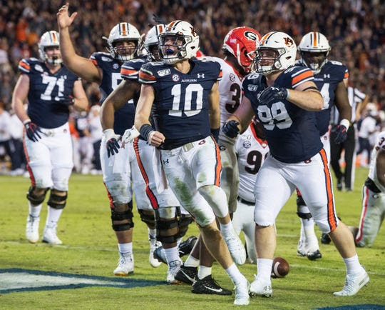 Auburn quarterback Bo Nix (10) celebrates his running touchdown at Jordan-Hare Stadium in Auburn, Ala., on Saturday, Nov. 16, 2019. Georgia defeated Auburn 21-14.