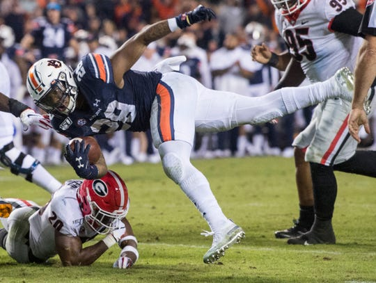 Auburn running back JaTarvious Whitlow (28) is stopped short of the goal line at Jordan-Hare Stadium in Auburn, Ala., on Saturday, Nov. 16, 2019. Georgia defeated Auburn 21-14.