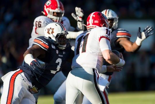 Auburn defensive lineman Marlon Davidson (3) sacks Georgia quarterback Jake Fromm (11) at Jordan-Hare Stadium in Auburn, Ala., on Saturday, Nov. 16, 2019. Georgia defeated Auburn 21-14.