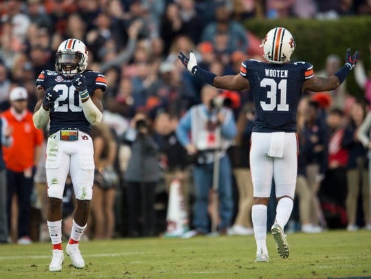 Auburn defensive back Jeremiah Dinson (20) and Auburn linebacker Chandler Wooten (31) get the crowed pumped up at Jordan-Hare Stadium in Auburn, Ala., on Saturday, Nov. 16, 2019. Georgia defeated Auburn 21-14.