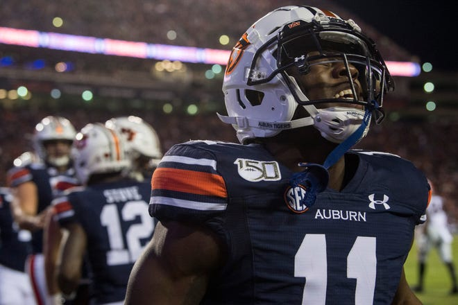 Auburn wide receiver Shedrick Jackson (11) celebrates Auburn wide receiver Eli Stove (12) touchdown at Jordan-Hare Stadium in Auburn, Ala., on Saturday, Nov. 16, 2019. Georgia defeated Auburn 21-14.