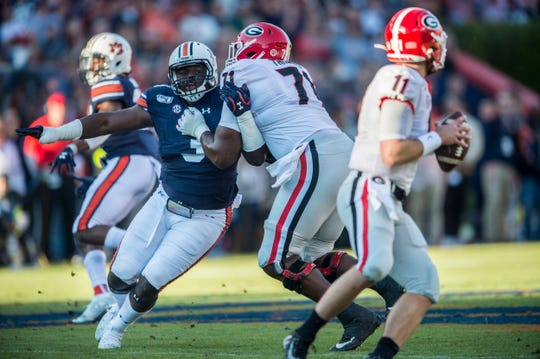 Auburn defensive lineman Marlon Davidson (3) makes his way to Georgia quarterback Jake Fromm (11) at Jordan-Hare Stadium in Auburn, Ala., on Saturday, Nov. 16, 2019. Georgia defeated Auburn 21-14.