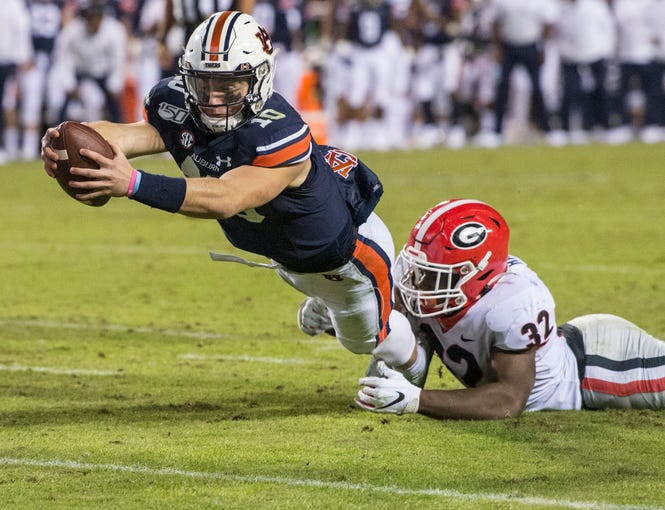 Auburn quarterback Bo Nix (10) dives in for a running touchdown at Jordan-Hare Stadium in Auburn, Ala., on Saturday, Nov. 16, 2019. Georgia defeated Auburn 21-14.