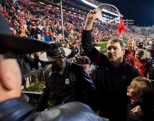 Georgia head coach Kirby Smart acknowledges the crowd at Jordan-Hare Stadium in Auburn, Ala., on Saturday, Nov. 16, 2019. Georgia defeated Auburn 21-14.