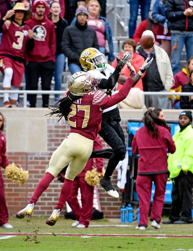 Nov 16, 2019; Tallahassee, FL, USA; Florida State Seminoles defensive back Akeem Dent (27) defends Alabama State Hornets wide receiver Tyrek Allen (8) during the game at Doak Campbell Stadium. Mandatory Credit: Melina Myers-USA TODAY Sports