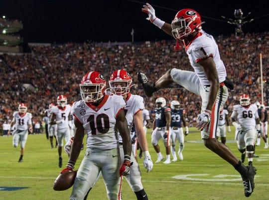 Georgia wide receiver Kearis Jackson (10) and Georgia wide receiver George Pickens (1) celebrates Jackson's touchdown, the play was later reversed at Jordan-Hare Stadium in Auburn, Ala., on Saturday, Nov. 16, 2019. Georgia defeated Auburn 21-14.