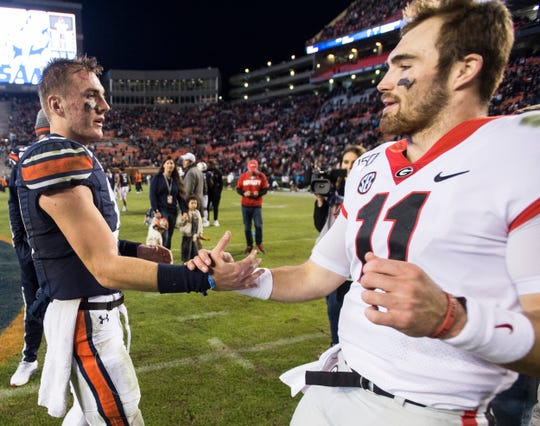 Auburn quarterback Bo Nix (10) shakes hands with Georgia quarterback Jake Fromm (11) after the game at Jordan-Hare Stadium in Auburn, Ala., on Saturday, Nov. 16, 2019. Georgia defeated Auburn 21-14.