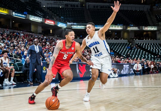 Ball State's Ishmael El-Amin dribbles the ball against Indiana State during their game at Bankers Life Fieldhouse Sunday, Nov. 17, 2019.
