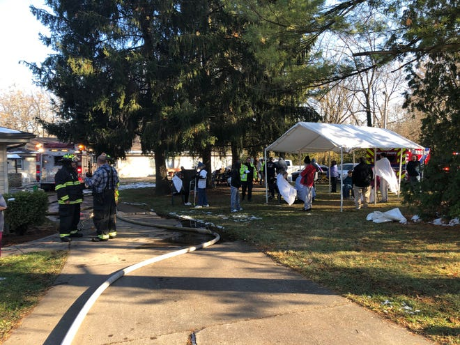 Residents and staff members at Rosewood Manor assisted living facility south of Muncie with emergency personnel on Satuday afternoon, after a dryer fire forced an evacuation.