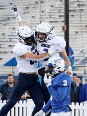 Rice wide receiver Brad Rozner (2) celebrates his touchdown with Rice tight end Jaeger Bull (82) as MTSU safety Gregory Grate Jr. (3) is in the foreground during the game on Saturday, Nov. 16, 2019, at MTSU.