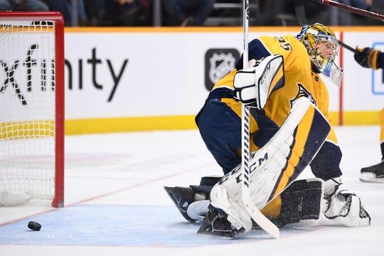 Nashville Predators goaltender Pekka Rinne (35) gets up after Chicago Blackhawks center David Kampf scored a goal during the second period at Bridgestone Arena in Nashville, Tenn., Saturday, Nov. 16, 2019.