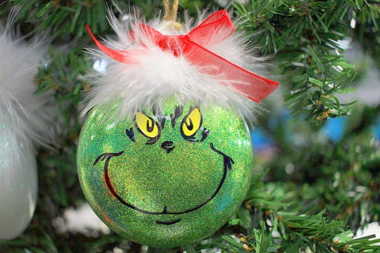 A Grinch Christmas ornament adorns a tree at the Christmas Harvest Craft Show in Gallatin, Tenn. on Saturday, November 16, 2019.