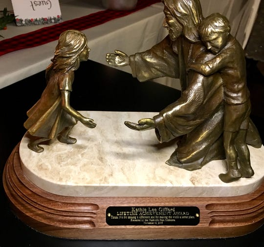 """A statuette of Jesus with two children is the Nashville Pops' first ever lifetime achievement award, presented to longtime TV talk show host Kathie Lee Gifford, who bought a house in Franklin in 2017. The inscription reads: """"Thank you for making a difference and making the world a better place."""""""