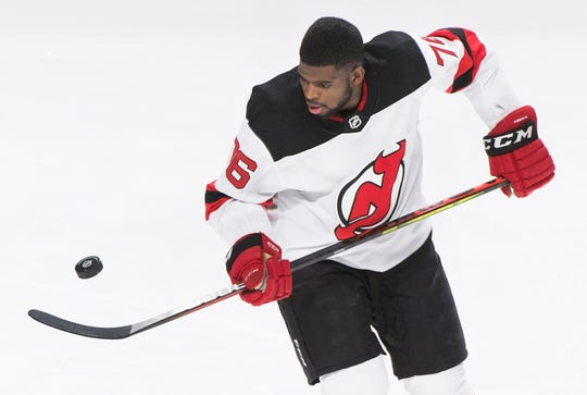 New Jersey Devils' P.K. Subban juggles the puck prior to an NHL hockey game against the Montreal Canadiens in Montreal, Saturday, Nov. 16, 2019. (Graham Hughes/The Canadian Press via AP)