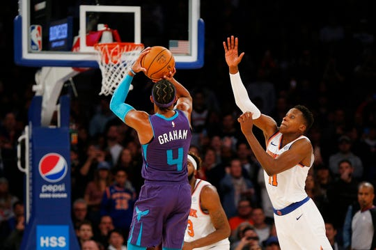 Nov 16, 2019; New York, NY, USA; Charlotte Hornets guard Devonte' Graham (4) hits a three point basket for the winning shot against the New York Knicks during the second half at Madison Square Garden. Mandatory Credit: Andy Marlin-USA TODAY Sports