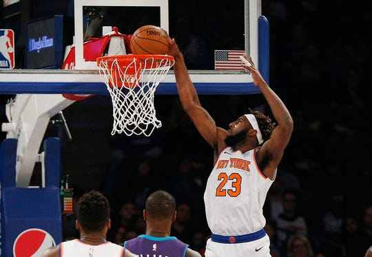 Nov 16, 2019; New York, NY, USA; New York Knicks center Mitchell Robinson (23) dunks the ball against the Charlotte Hornets during the first half at Madison Square Garden. Mandatory Credit: Andy Marlin-USA TODAY Sports