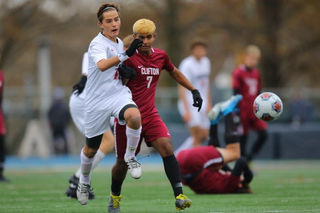 Hunterdon Central's Luis Etcharren (left) and Clifton's Giovanni battle for the ball during the second half of their Group IV final on Sunday, Nov. 17, 2019.
