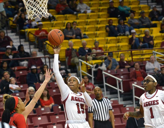 NMSU Aggie Rodrea Echols goes in for a layup against the UNM Lobos on Sunday afternoon at the Pan Am.  Photo taken 11/17/19.