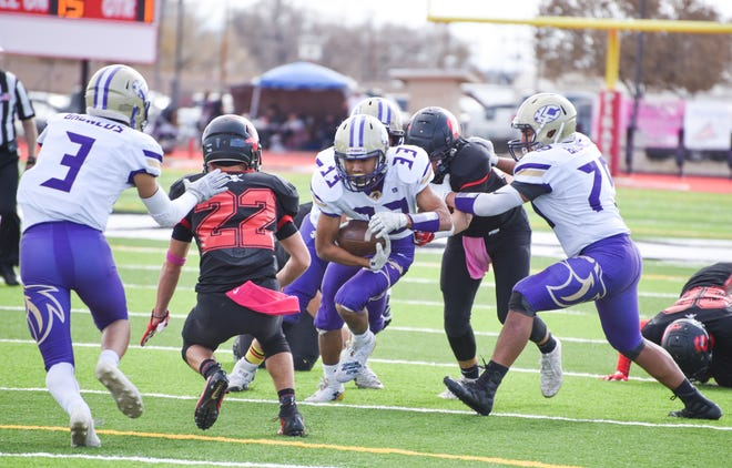 Kirtland Central's Zakk Thomas runs up the middle during Saturday's 4A state quarterfinals football game at Grants.