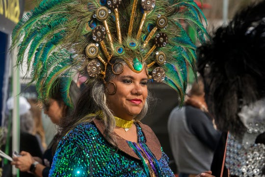Rosy Carrion of the Krewe de Karnaval gets ready to perform during last year's Pensacola Latino Festival. The Krewe de Karnaval returns with Fiesta de Karnaval on Saturday at Seville Quarter.