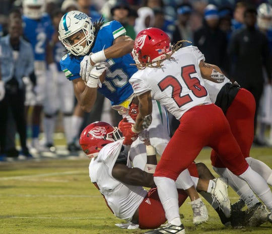 West Florida's Kevin Grant (15) is brought down during first half action against West Alabama at Blue Wahoos Stadium Saturday, November 16, 2019.
