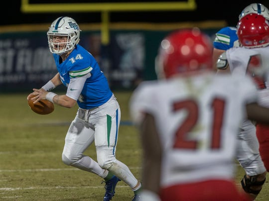West Florida's Austen Reed looks for a receiver during first half action against West Alabama at Blue Wahoos Stadium Saturday, November 16, 2019.