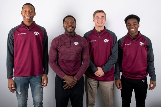 (From left) Gettysburg boys' basketball team members Quadir Copeland, head coach Lawrence Williams, Zach Ketterman and Charles Warren pose in the GameTimePA photo booth during YAIAA winter sports media day at the York Daily Record on Sunday, November 17, 2019.