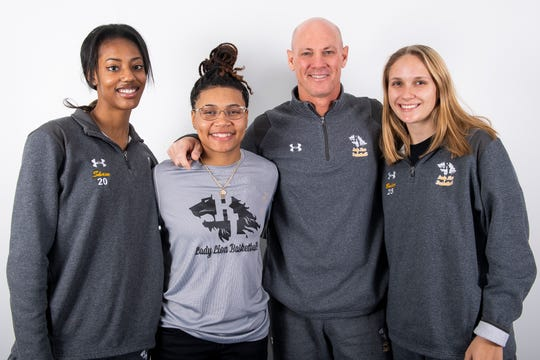 (From left) Red Lion girls' basketball team members Makiah Shaw, Asia Eames, head coach Don Dimoff and Julia Beiler pose in the GameTimePA photo booth during YAIAA winter sports media day at the York Daily Record on Sunday, November 17, 2019.