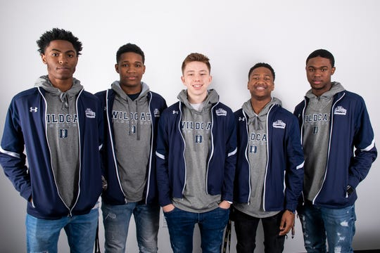 (From left) Dallastown boys' basketball players Kobe Green, Roman Owens, Nike McGlynn, Michael Dickson and Jadon Green pose in the GameTimePA photo booth during YAIAA winter sports media day at the York Daily Record on Sunday, November 17, 2019.