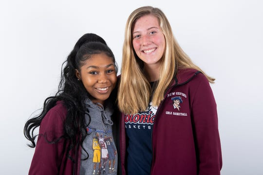 (From left) New Oxford girls' basketball players Jayla Brown and Morgan Adams pose in the GameTimePA photo booth during YAIAA winter sports media day at the York Daily Record on Sunday, November 17, 2019.