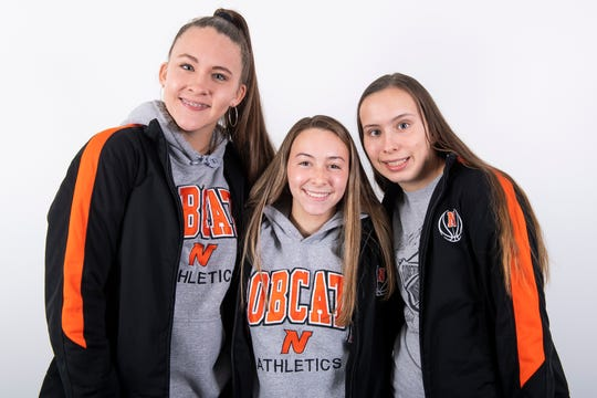(From left) Northeastern girls' basketball players Jordyn Jennings, Maddie Hall and Logan Jennings pose in the GameTimePA photo booth during YAIAA winter sports media day at the York Daily Record on Sunday, November 17, 2019.