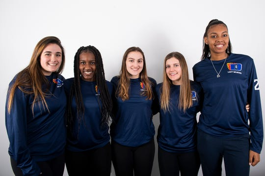 (From left) Dallastown girls' basketball players Danika Moose, D'Shantae Edwards, Ashley Harbold, Claire Teyral and Aniya Matthews pose in the GameTimePA photo booth during YAIAA winter sports media day at the York Daily Record on Sunday, November 17, 2019.