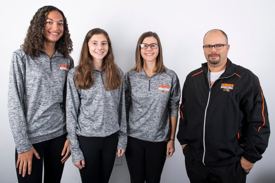 (From left) Hanover girls' basketball players Tianna Gray, Jaycie Miller, Madelyn Hutton and head coach Denny Garman pose in the GameTimePA photo booth during YAIAA winter sports media day at the York Daily Record on Sunday, November 17, 2019.
